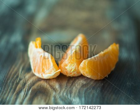 Fresh mandarines with leaves on wooden table, close up