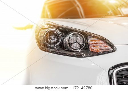 Modern sport car isolated on a white background with sunlight
