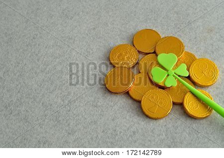 Golden coins with a shamrock for St. Patrick's day