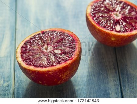 Red Spanish oranges on a wooden background. Close-up