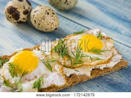 Sandwich with fried quail eggs