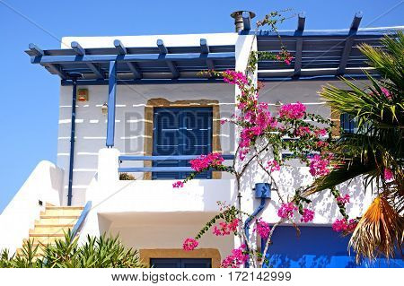MAKRIGIALOS, CRETE - SEPTEMBER 18, 2016 - Pretty villa terrace with Bougainvillea Makrigialos Crete Greece Europe, September 18, 2016.