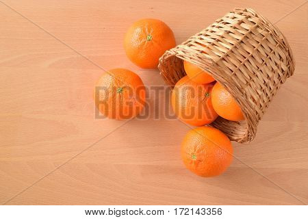 Whole citrus mandarine are on the table
