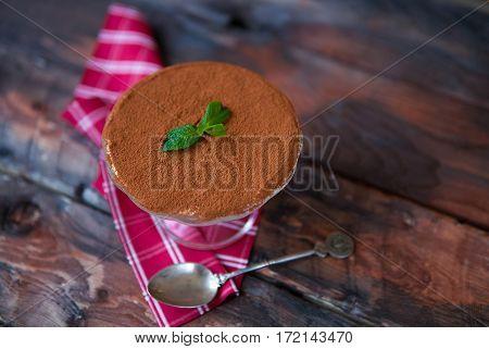 Tiramisu On A Red Napkin On Dark Wooden Background. Traditional Italian Dessert, Rustic, Country Sty