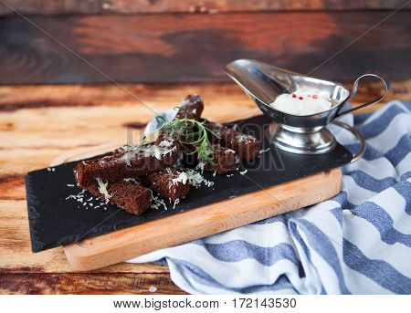 Fragrant Toasts From Black Bread With Cheese Parmesan And White Sauce Are Served On A Blue Napkin On