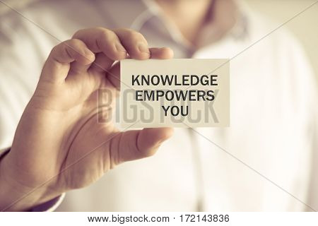 Businessman Holding Knowledge Empowers You Message Card