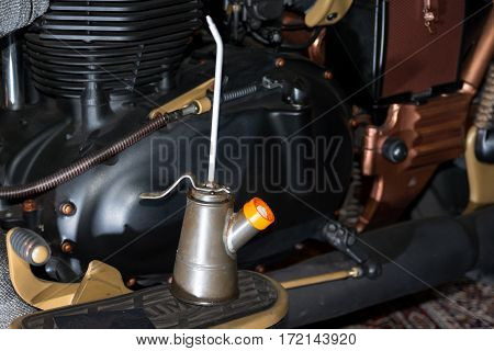 Particular of an old motorcycle engine and tools