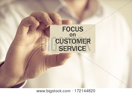 Businessman Holding Focus On Customer Service Message Card