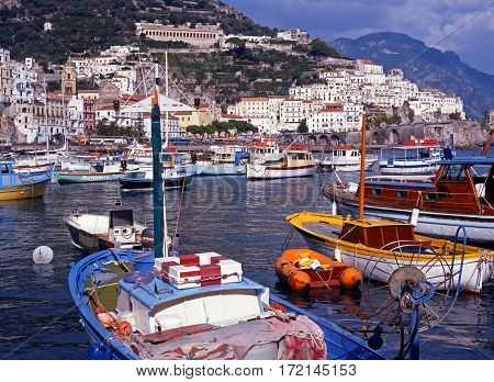 AMALFI, ITALY - SEPTEMBER 22, 1996 - Boats and yachts in the harbour with views towards the town Amalfi Amalfi Coast Italy Europe, September 22, 1996.
