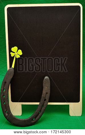 A horse shoe and a shamrock for St. Patrick's day