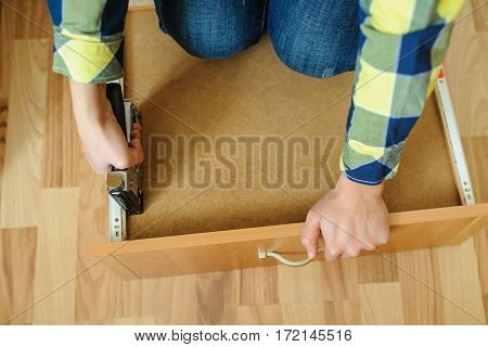 Worker Repairing Furniture With Industrial/construction Stapler