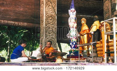 Siem Reap Cambodia - July 14 2013: offering ceremony in buddhist temple between women and monk