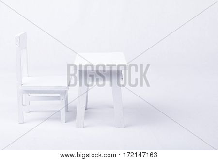 White wooden chair and desk in classroom on a white background
