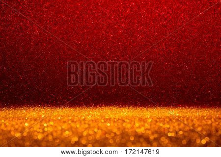 Abstract background filled with shiny gold and red glitter