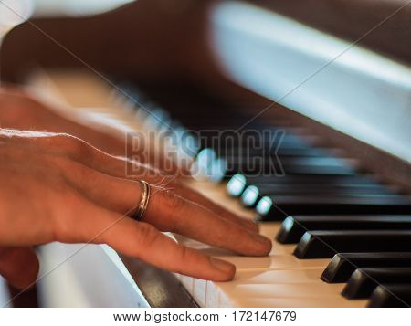 Close up of musician hands playing classic piano