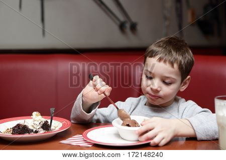 Child eating ice cream in a cafe
