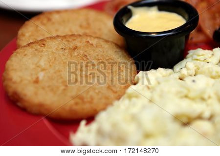 Potato fritters with scrambled eggs and sauce