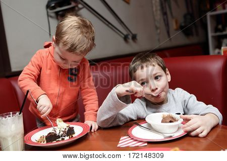 Two Brothers Have Ice Cream