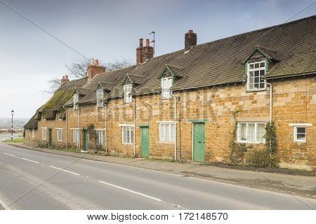 An image of a row of cottages in the small picturesque village of Rockingham Northamptonshire England UK.