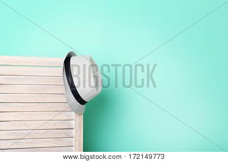 Hat Hanging On Wooden Folding Screen On A Green Background