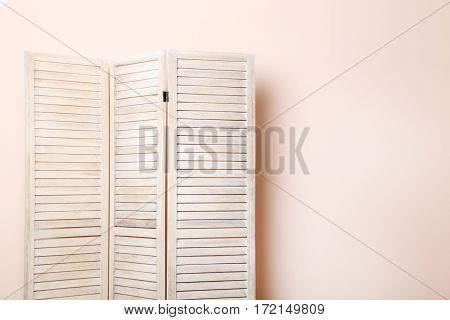 Wooden Folding Screen On A Beige Background