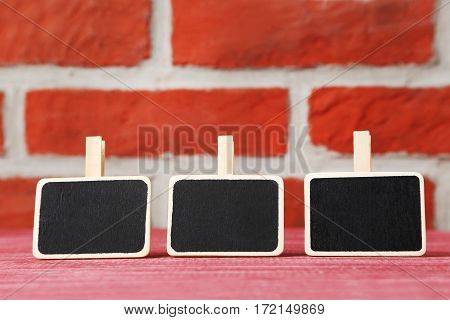 Small Blackboards On A Brick Wall Background