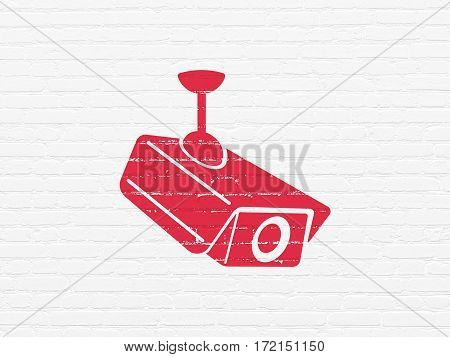 Protection concept: Painted red Cctv Camera icon on White Brick wall background