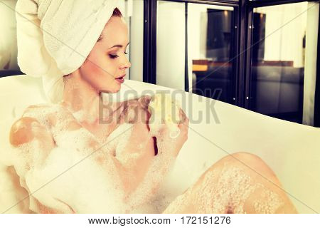 Red-haired Beautiful Young Woman With A Towel On Her Head After