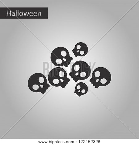 black and white style icon of halloween skulls