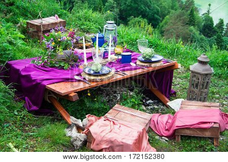 Wedding table setting decorated in rustic style. Wedding inspiration on mountain. Outdoor