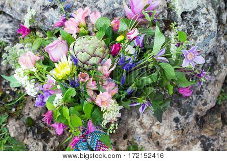 Rustic Wedding Bouquet Of Colorful Flowers And Succulent On Stones. Beauty Of Colored Flowers. Close