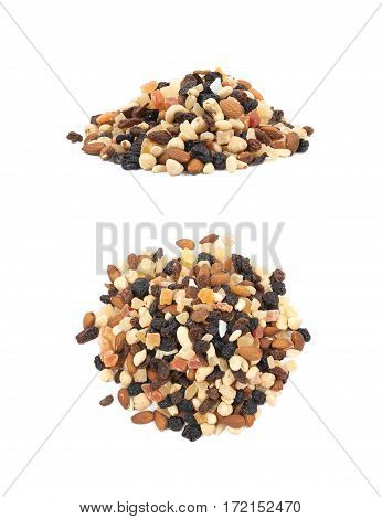 Pile of mixed nuts and dried fruits isolated over the white background, set of two different foreshortenings