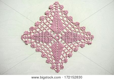 Napkin pale pink  colored, related crochet of synthetic yarn