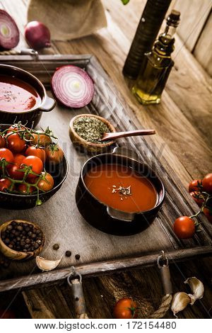 Tomato soup. Homemade tomato soup with tomatoes herbs and spices. Comfort food.