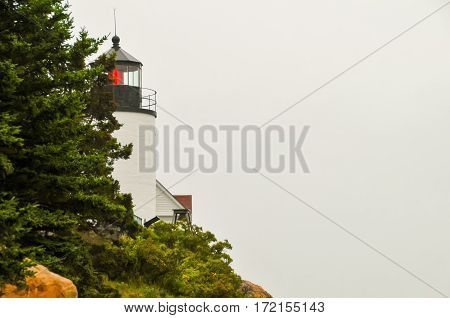 A close up of the Bass Harbor light house with a red light