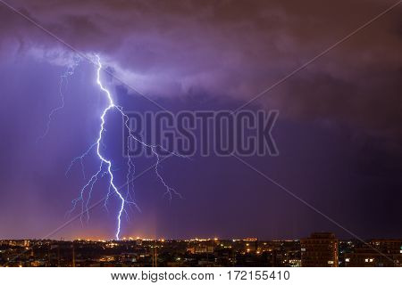 Beautiful lightning above the night city Stormy weather