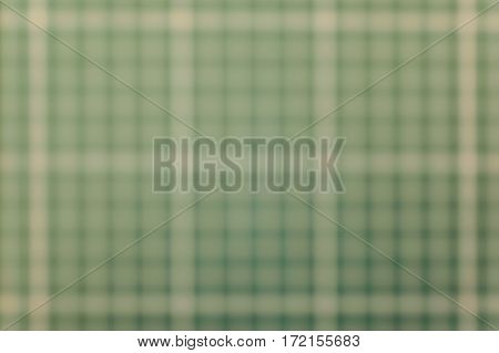 Green and white blurred vague drafting grid background