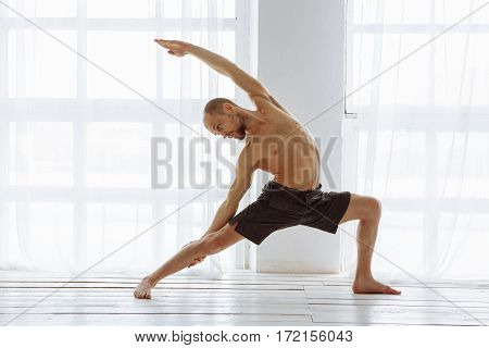 Man practicing advanced yoga. A series of yoga poses. lifestyle concept.