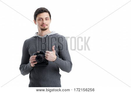 young successful professional photographer in shirt use DSLR digital camera and showing OK gesture isolated on white background