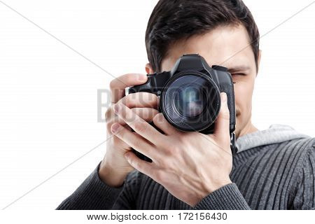 young successful professional photographer in shirt use DSLR digital camera isolated on white background. closeup
