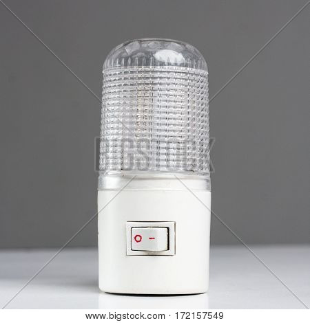 A new generic LED night light that turns on automatically in darkness on a white background.
