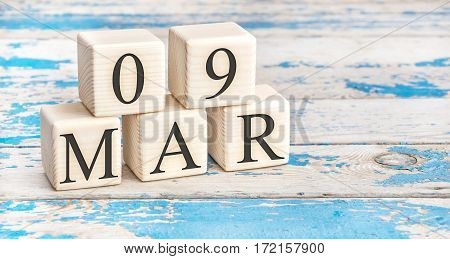 March 9Th. Wooden Cubes With Date Of 9 March On Old Blue Wooden Background.