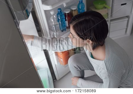Woman Taking Food Out Of The Fridge