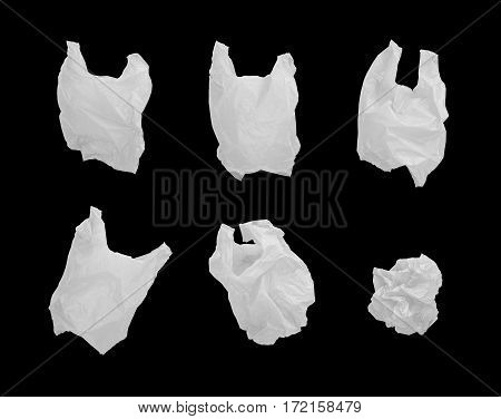 Collection of white color plastic bag in different composition isolated on black background.