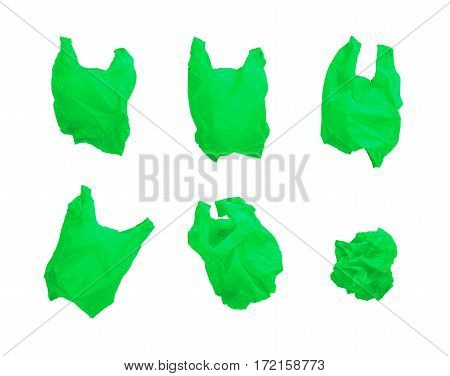 Collection of green color plastic bag in different composition isolated on white background.