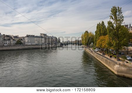 PARIS FRANCE - OCTOBER 12 2015: The Ile de la Cite (Cite Island) is one of two remaining natural islands in the Seine within the city of Paris France