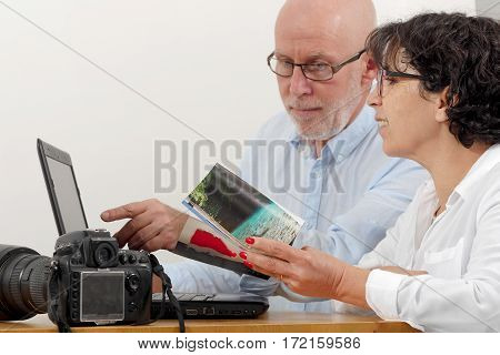 a senior couple preparing a vacation trip