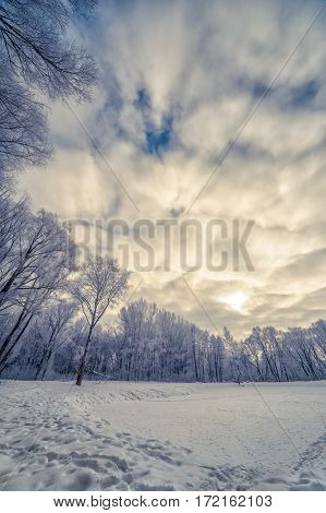 winter landscape with deep Amazing Clouds on Deep Blue Sky
