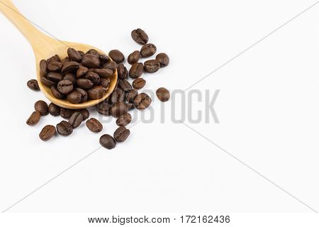 coffee beans in wooden scoop and coffee beans isolated on white background