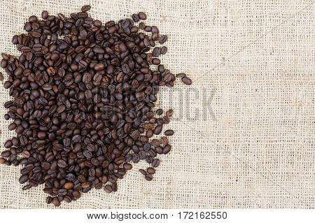 roasted coffee beans on cloth sack background